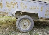 Metal wagon wheel in — Stock Photo