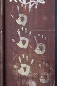 Handprints on wall — Stock Photo