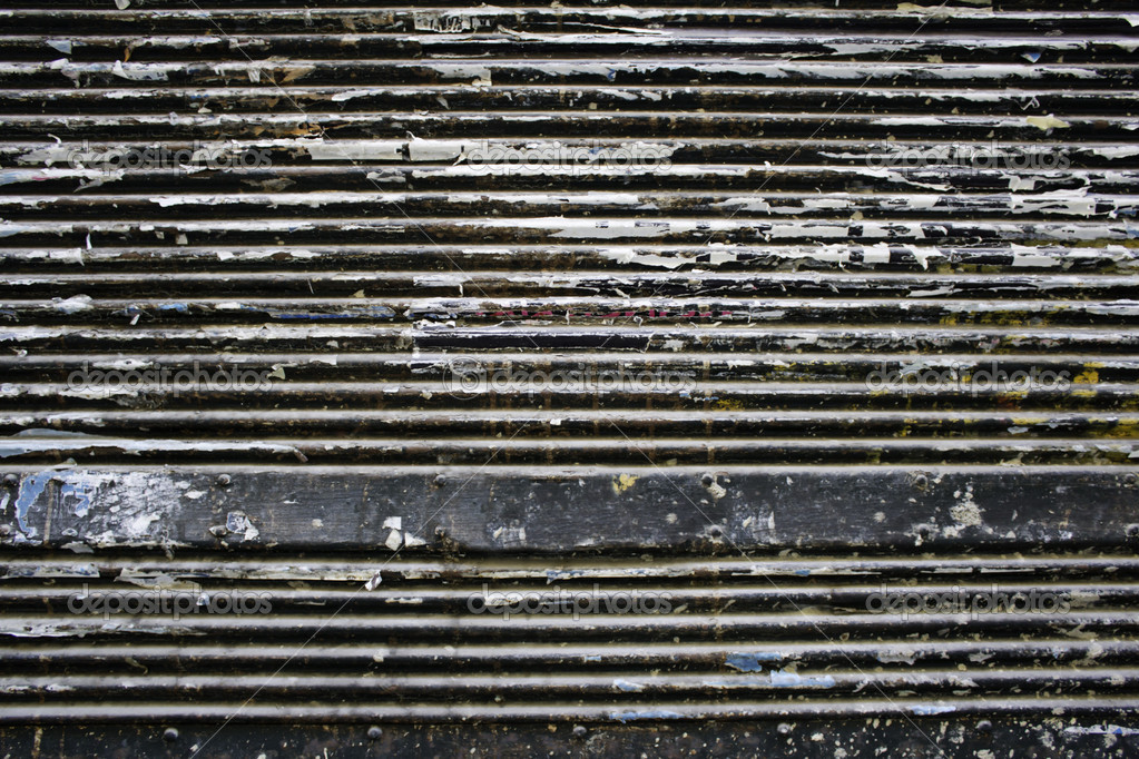 Door closed metal of iron, at the entrance of a business — Stock Photo #14831617