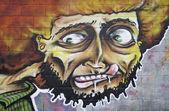 Young face graffiti — Stock Photo