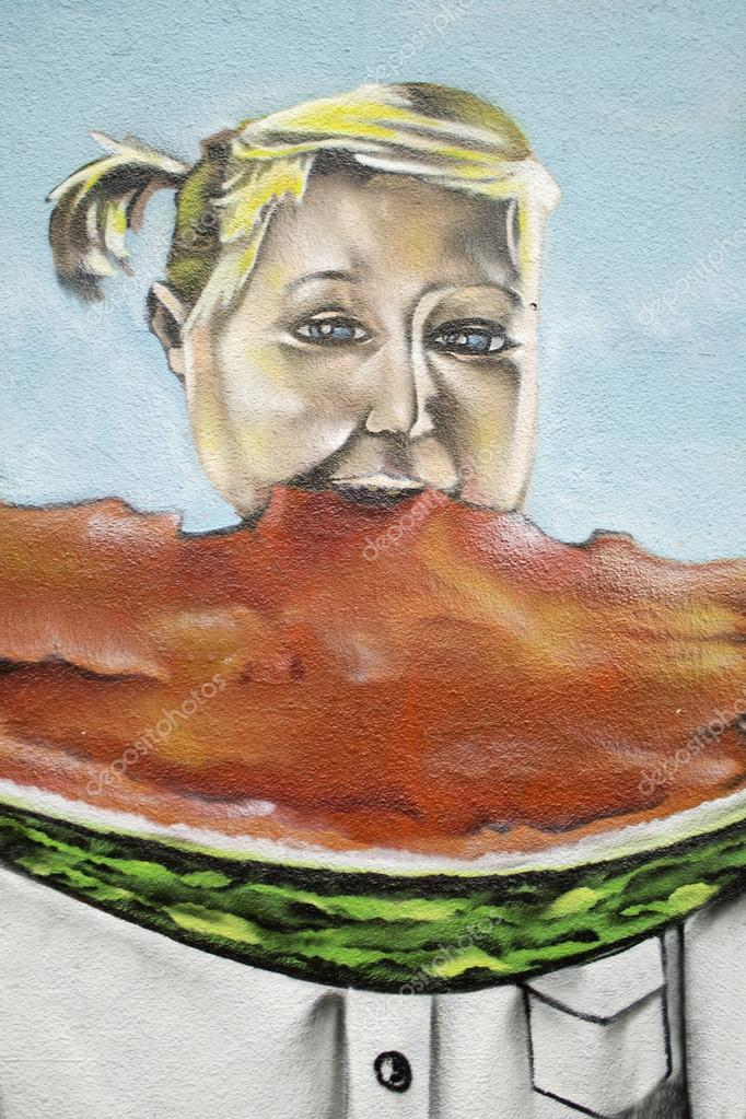 Girl eating watermelon drawn on the wall, urban art, greengrocers — Stock Photo #15057307