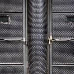 Black textured door — Stock Photo