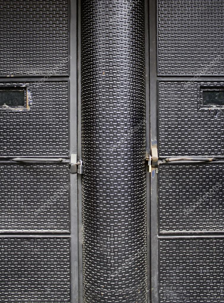 Black textured door closed, business entry, decoration — Stock Photo #15776243