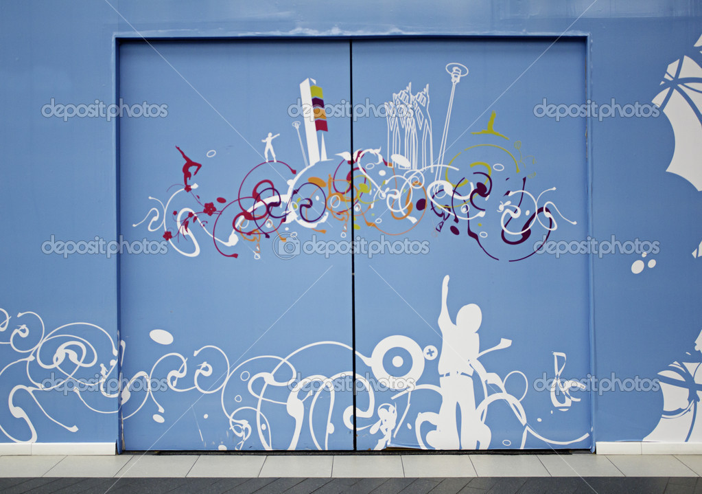 Blue door with artistic decorations and painting, modern decoration  Stock Photo #15888043