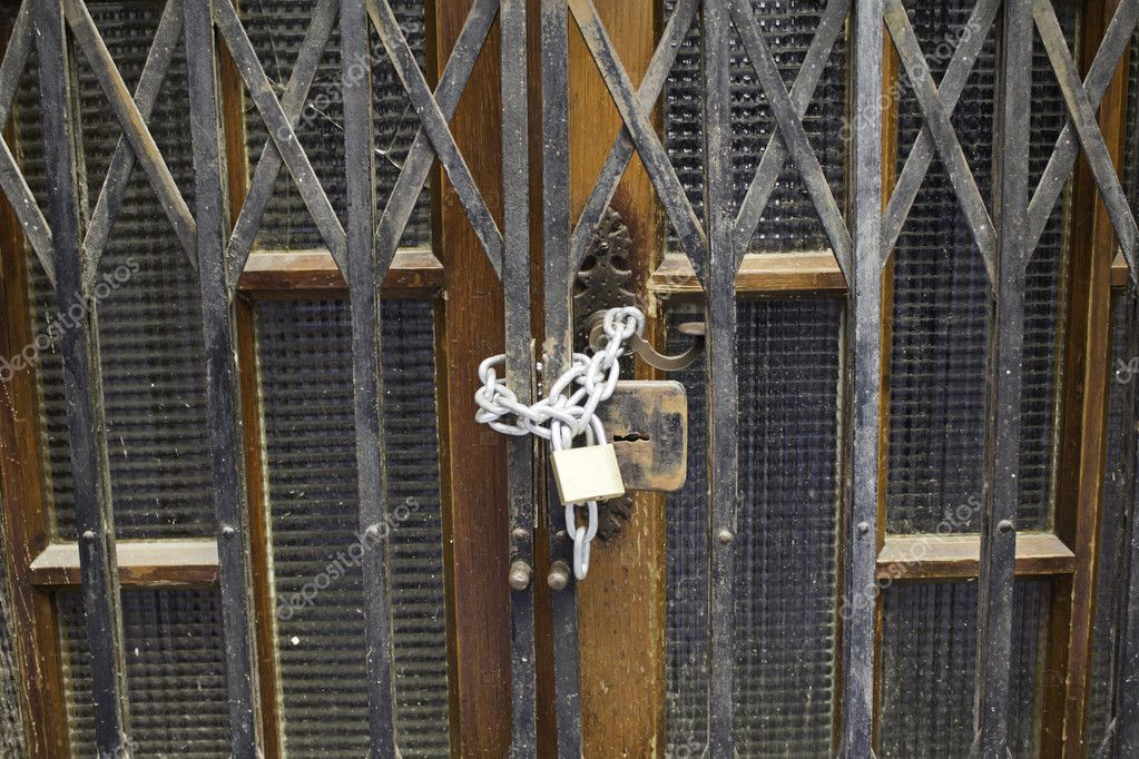 Business and padlocked chains, metal door — Stock Photo #16303971