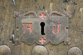 Lock with symbols — Stock Photo