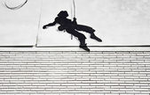 Climber on wall — ストック写真