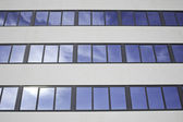Skyscraper with reflection of sky — Stock Photo