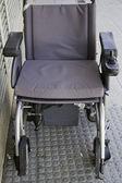 Wheelchair on urban street — Stock Photo