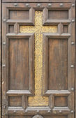 Cross on door — Stock Photo