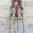 Youth on stilts — Stock Photo