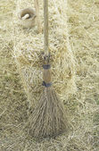 Broom with straw bale — Stock Photo