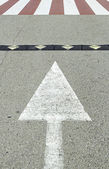Arrow with zebra crossing — Stock Photo