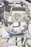 Robot i urban wall — Stockfoto