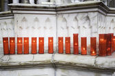 Red candles lit — Stock Photo