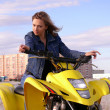 Royalty-Free Stock Photo: Dyakova Helen on quadrocycle.