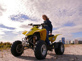 Beautiful blonde on sport quadrocycle. Sidebar. — Stock Photo