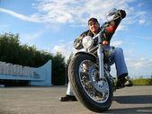 Classical biker Klimenko Oleg in black spectacles sits on chopper. Nadym, Russia. — Stock Photo