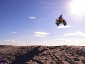 Vadim Vasuhin in high jump with springboard on quadrocycle during extreme motorcross racing August 26, 2007 in Nadym, Russia. — Stock Photo