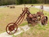 Amusing and rusty model of trike. Western Australia, near Albany. — Zdjęcie stockowe