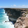 Breakaway, high rocky seaside with surf of the National park Nullarbor. South Australia. — Stock Photo