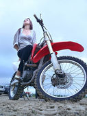 Beautiful girl on a motorcycle. — Stock Photo