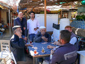 Unfamiliar Turkish men, in a cafe, drinking drinks and play cards in Turkey, Erzinkan - November 3, 2008. — Stock Photo