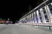 Office building close-up. City of winter. Beautifully illuminated building and trees. Far north, Nadym. — Stock Photo