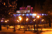 New Year - a holiday in Nadym, Russia - February 28, 2013. Festive street decorations. Beautifully illuminated building and trees. Far north, Nadym. — Stock Photo