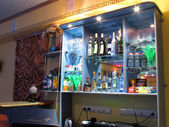 Restaurant. Interior space. Bar with a varied selection of booze in Nadym, Russia - March 30, 2006. — Stock Photo
