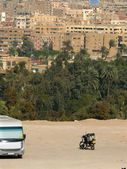 Bus and a motorcycle near the city of Cairo in Cairo, Egypt - November 9, 2008. — Stock Photo