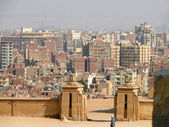 Unknown man at the gate of the city of Cairo. View of the city. Architectural city buildings. — Stock Photo