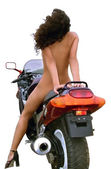 Beautiful naked girl on a motorcycle on a white background. — Stock Photo