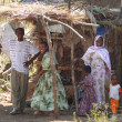 ROBY, ETHIOPIA - NOVEMBER 23, 2008: An unknown Ethiopian family parents and children outside his home — Stock Photo