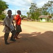 LINDI, TANZANIA - DESEMBER 2, 2008: Two unfamiliar boys cross th — Stock Photo