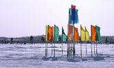 Russia, Nadym. Festive flags on the background of the Northern n — Stock Photo