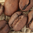 Coffee beans background sacking - Stock Photo