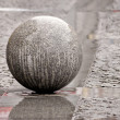 Stock Photo: Sphere from a granite in streets of city