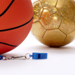 Balls and whistle on a white background — Stock Photo