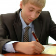 Teenager - businessman signs document. — Stock Photo #12332298