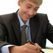 Teenager - businessman signs document. — Stock Photo #12332299