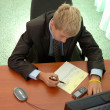 Teenager - businessman signs document. — Stock Photo #12332303