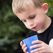 Young Boy Drinking from Blue Plastic Cup — Stock Photo