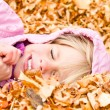 Little Girl Lying in Autumn Leaves — Stock Photo