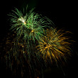 Bursts of Green and Gold Fireworks — Stock Photo