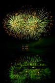 Bursts of Green and Orange Fireworks — Stock Photo