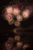 Bursts of Orange and Pink Fireworks — Stock Photo