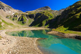 Green water mountain lake in Hohe Tauern National Park — Stock Photo