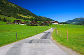 Rural road in alpine village — Stock Photo