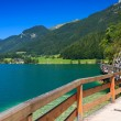 Wooden walkway along beautiful Wolfgang lake in Alps Mountains — Stock Photo #12734114